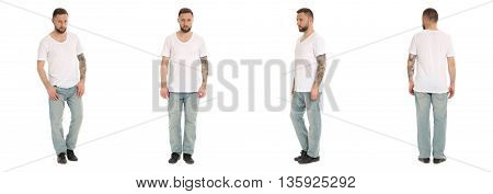 Young Man In Jeans With Tattoos Looking Tough