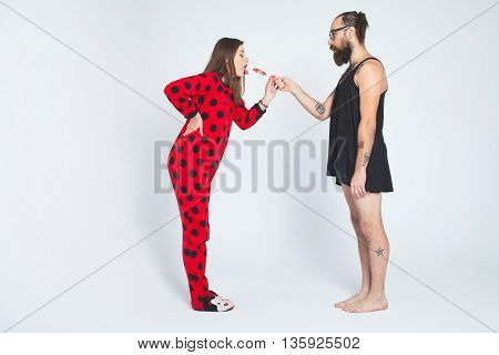 Portrait of a funny love couple hugging each other isolated on white background