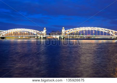 Peter the Great Bridge at night in St.Petersburg Russia.