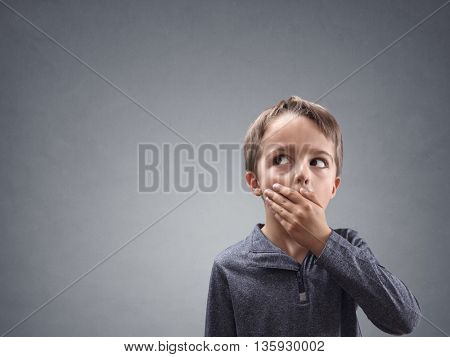 Shocked and surprised boy looking into copy space concept for amazement, astonishment, making a mistake, stunned and speechless or back to school