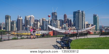 CALGARY, CANADA - JUNE 5: Calgary's skyline with the Scotiabank Saddledome in the foreground June 5, 2016 in Calgary, Alberta. The Saddledome is home to the Calgary Flames NHL club.