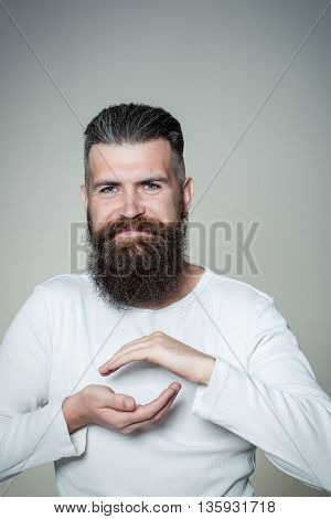 Bearded Man Showing Small Size