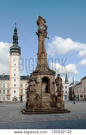 Plague Column in the square in Litovel Town Hall tower in the background, Czech Republic