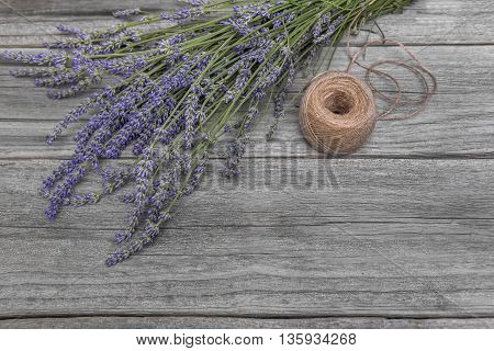 Bouquet of lavender and thread on a wooden table. Still life.