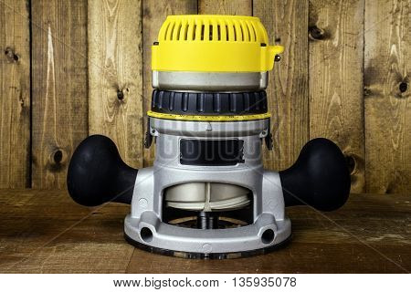 electric fixed base router on wood background