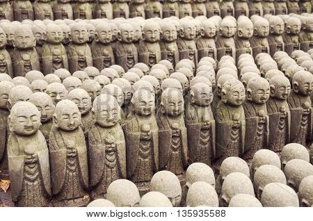 rows of similar Japanese Jiizo sculptures; focus on central part