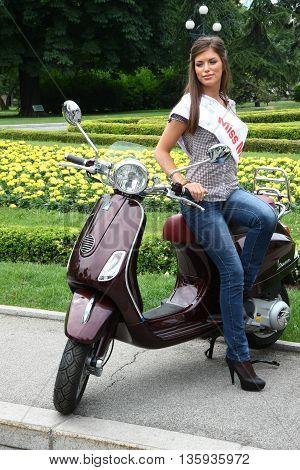 BELGRADE SERBIA-JUN 11, 2011:Model pose at traditional manifestation, Vespa meeting