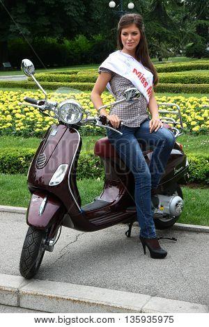 BELGRADE SERBIA-JUN 11, 2011-Model pose at traditional manifestation, Vespa meeting