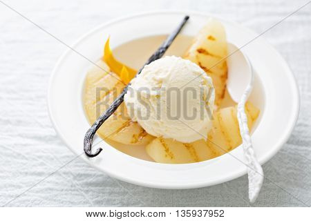 Dessert with ice cream and grilled poached pears