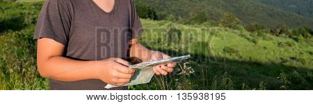 Boy Hands Holding Tablet In Against Nature Background