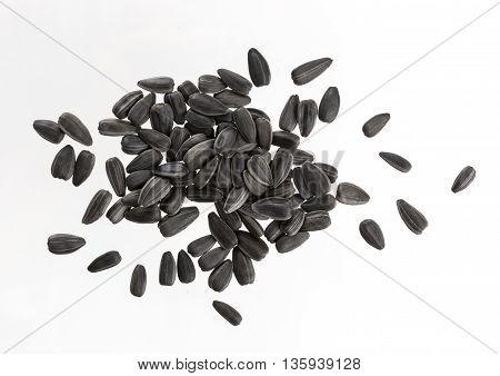 Black sunflower seeds isolated on white background. Pile of sunflower seeds isolated.