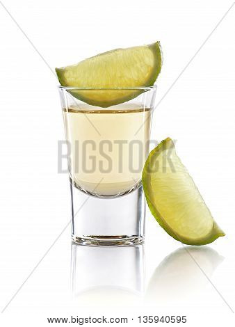 A tequila shot with a slices of lime