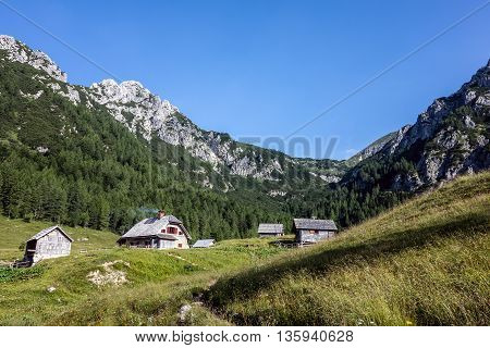 Slovenian landscape with wooden chalets ecological agriculture