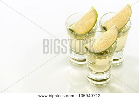 Toned image. A tequila shots with a slice of lime