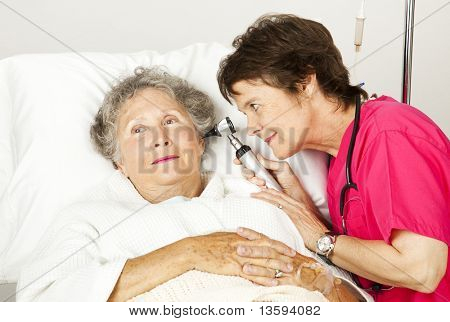 Senior woman gets a medical exam from a nurse in the hospital.