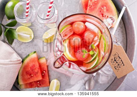 Watermelon drink with lime in a small pitcher
