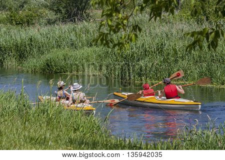 Bialystok Poland June 25 2016 : Four people canoeing float peaceful natural river