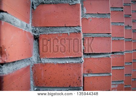 Wall made of red bricks and cement