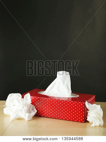 Cleaning wipes on a brown wooden background