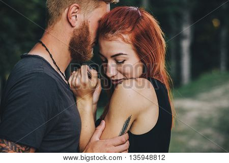 beautiful couple hugging each other on the background of the forest