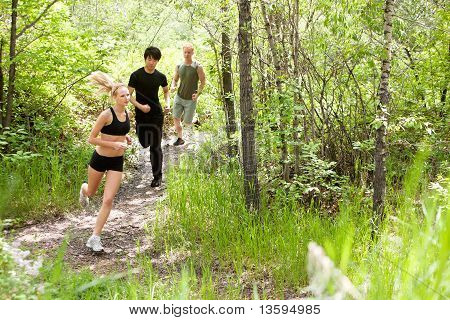 Friends running in the forest