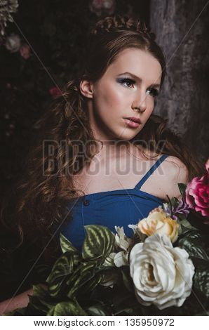 Portrait of the beautiful fairy young woman with beauty make up, hairstyle on natural forest background. Style fashion photo image of the girl princess. Forest nymph, studio shot.