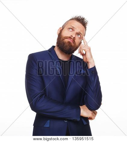 Young bearded man isolated at white background. Portrait of guy with beard thoughtful, pensive, charming and smiling, looking up. Trendy hipster think of problem solving, finding solution