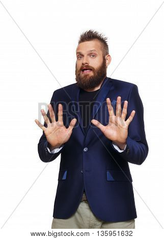 Scared man portrait isolated at white. Thrilled, terrified, frightened emotional man with beard in blue suit show stop gesture with hands. Disgust, dislike, man afraid of something