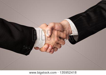 Business handshake on gradient background