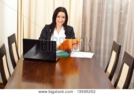 Single Business Woman At Meeting Table