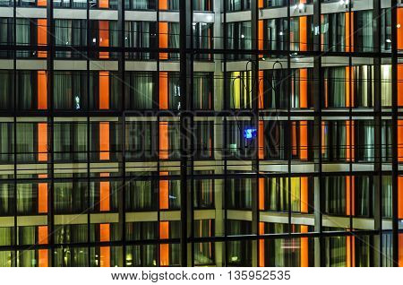 Illuminated night front facade of modern building