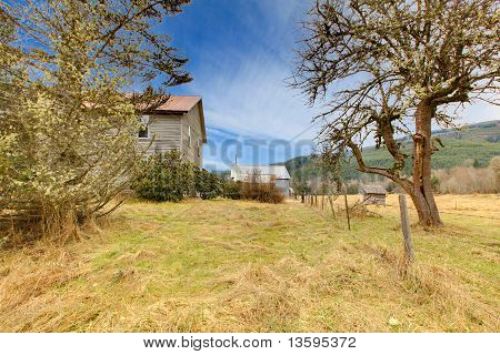 Old Grey Rustic House With Winter Country Landscape