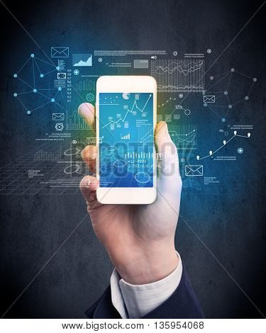 Caucasian hand in business suit holding a smartphone