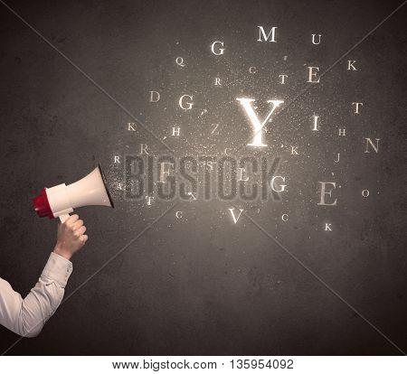 Caucasian arm holding megaphone with letter cloud