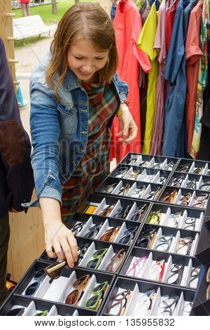 MOSCOW - JUNE 4: People buying sunglasses on International Jazz Festival