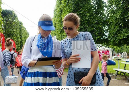MOSCOW - JUNE 4: Agents of insurance company interview visitors on International Jazz Festival