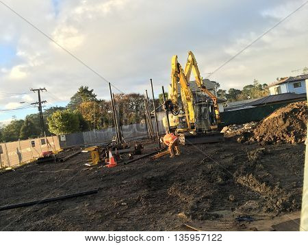 AUCKLAND JUN. 17: Construction workers setting up building foundation at project construction work site in Auckland New Zealand taken on June 17 2016.