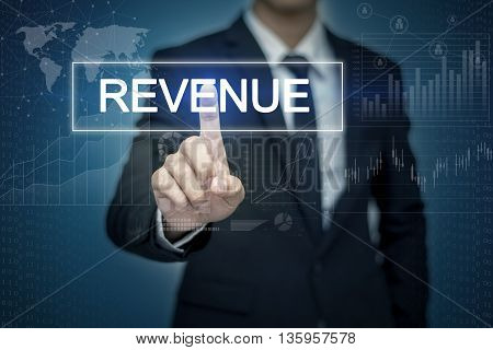 Businessman hand touching REVENUE button on virtual screen