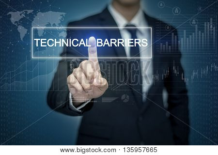 Businessman hand touching TECHNICAL BARRIERS button on virtual screen