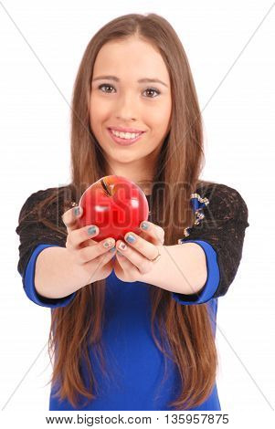 Young girl offering a apple to someone focus on apple. Isolated on white background
