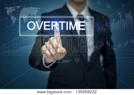 Businessman hand touching OVERTIME button on virtual screen