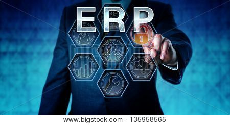 Business manager in blue suit is pushing ERP on an interactive virtual control monitor display. Business metaphor and supply chain management term. Acronym for Enterprise Resource Planning.