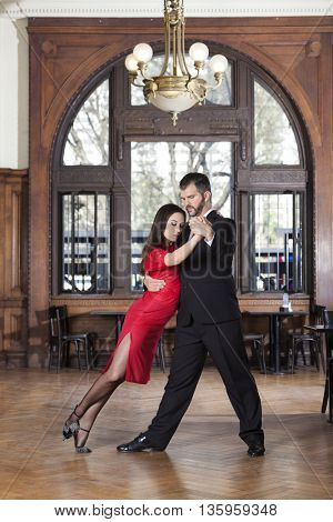 Full Length Of Dancer Leaning On Partner While Performing Tango