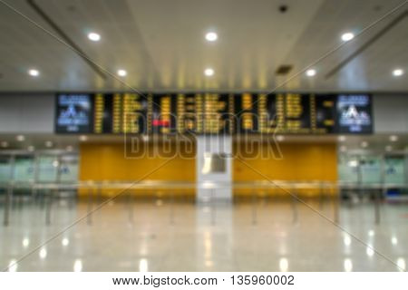 Airport arrival area and arrival schedule display - blurred