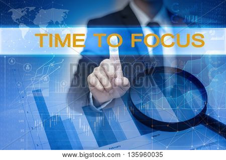 Businessman hand touching TIME TO FOCUS button on virtual screen