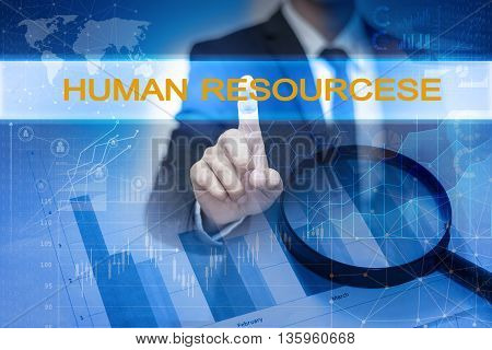 Businessman hand touching HUMAN RESOURCESE button on virtual screen