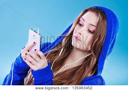 Young Woman With Smart Phone Listening Music