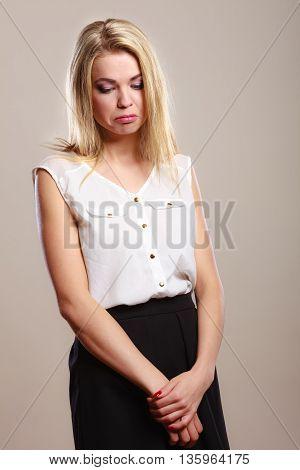 Loneliness stress depression. Sad unhappy girl portrait on gray