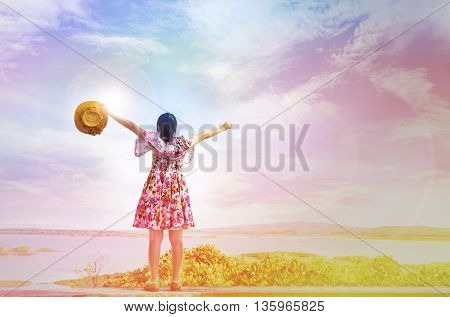 Girl Raising Arms Up High To Sky Embrace Colourful World