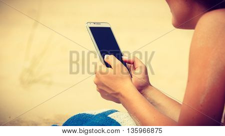 Woman On Beach Texting On Smartphone.